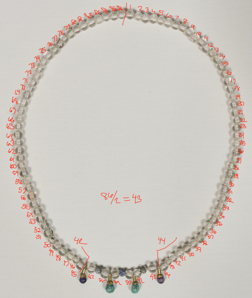 Image of the rock crystal necklace with my notations on it counting the beads.