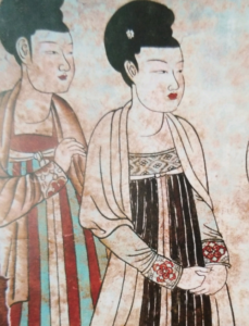 4. Detail of female servants from a mural in the tomb of Duan Jianbi (651), with decorated waistlines and cuffs, and one with a striped skirt.