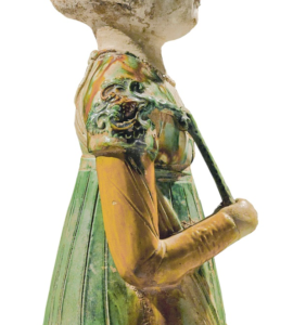 8. Detail of female figurine sold at Sotheby's, dating from the Tang Dynasty, showing how the shirt and half-sleeved jacket lay at the neckline.